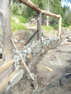 Rear wall and unstained logs.